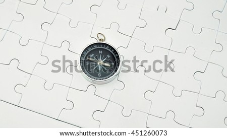 Compass on white puzzle