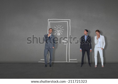 Composite image of business people standing against black wall