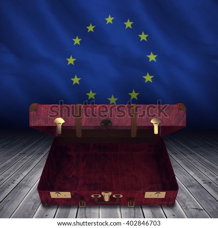 Composite image of opened suitcase against close-up of european flag
