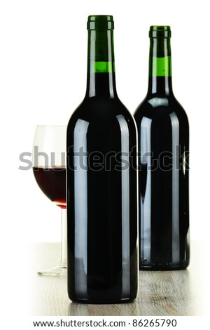 Composition with bottles of wine and wineglass isolated on white