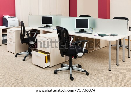 computers on a desk in a modern office