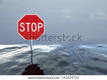 Concept image of a stop sign at a flooded intersection