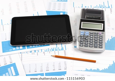 Concept of business report analysis - digital tablet, graph, sheet, calculator and pencil. You may place your own screen, for example web page on tablet screen.