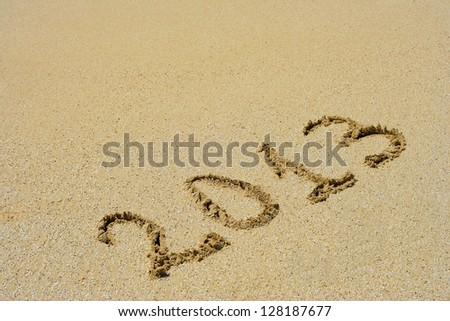 Concept or conceptual hand made or handwritten 2013 year text in sand on a beach in an exotic island as metaphor to tropical,summer,sea,ocean,calendar,travel,holiday,sunny,tourism,resort,time or relax