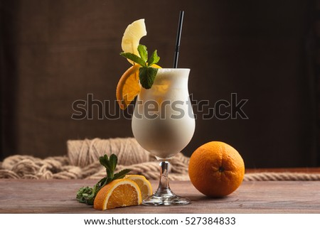 Concept: restaurant menus, healthy eating, homemade, gourmands, gluttony. Milk shake with ingredients and vintage cutlery on wooden background.