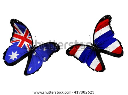 Concept - two butterflies with Australia and Thailand  flags flying