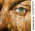 Conceptual image of a face with a bark brown skin - stock photo