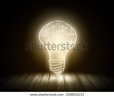 Conceptual image with light bulb and wooden surface