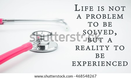 Conceptual Image With Quotes LIFE IS NOT A PROBLEM TO BE SOLVED, BUT A  REALITY