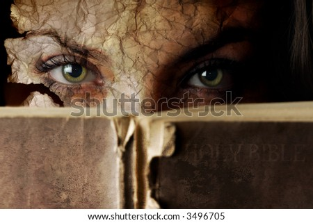 Conceptual photo of old Bible and cracked face
