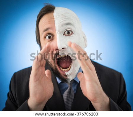 Conceptual two sides face portait photo of a businessman