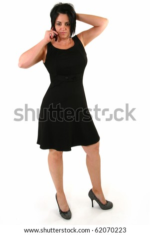Concerned 40 year old on cellphone in black dress over white background.