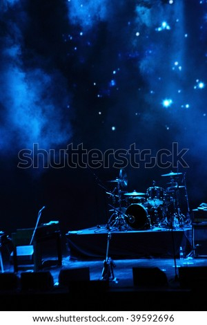 concert stage in blue light with smoke