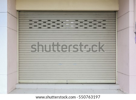Concrete building with roller shutter door