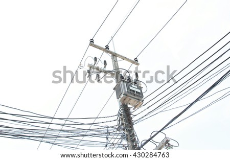Concrete electric pillar with crossing cables.electric transformer on pole.