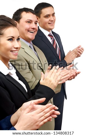Confident business partners applauding at meeting
