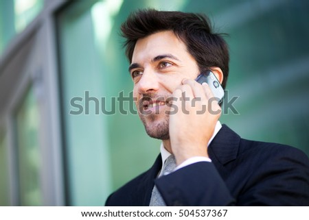 Confident businessman talking at the phone