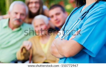 Confident doctor welcoming patients, happy family members - family medical care concept.