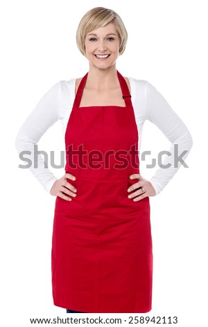Confident woman chef with hands on her waist