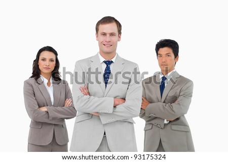 Confident young businessteam with arms folded against a white background