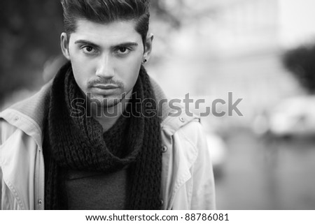 confident young man on street.