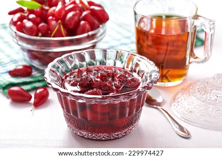 Confiture with fruits of cornel in glass bowl