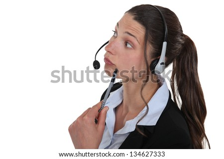 Confused brunette call center worker