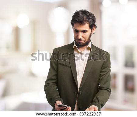 confused businessman with mobile