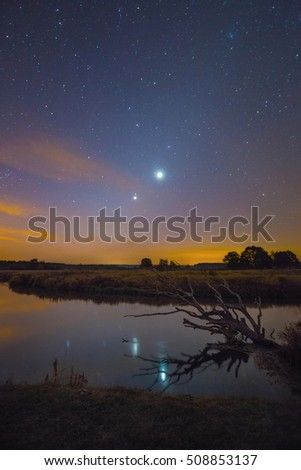 Conjunction of Jupiter and Venus over the river