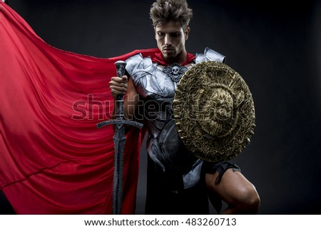 Conqueror, centurion or Roman warrior with iron armor, military helmet with horsehair and sword
