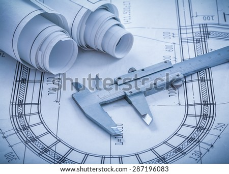 Rolled construction blueprints building concept stock for Architectural metal concepts nj