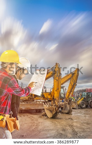 Construction manager on the construction site at sunset as a background Construction