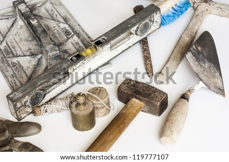 Construction masonry cement mortar tools on white