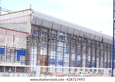 Construction site, workers on scaffolding