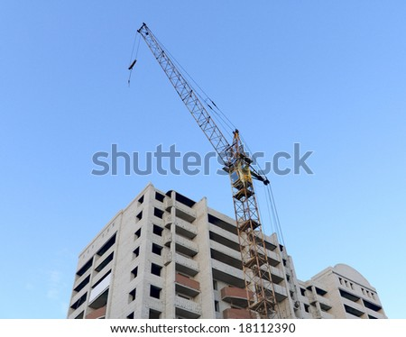 Construction - the elevating crane and unfinished brick house