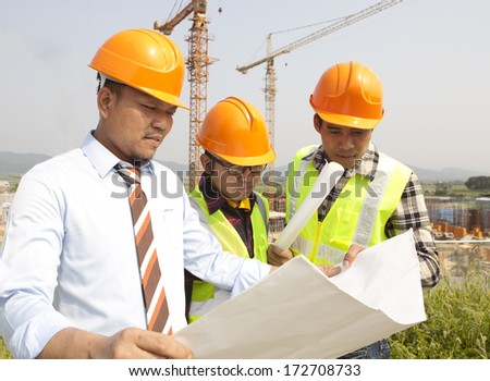 Construction worker team work discussion on location