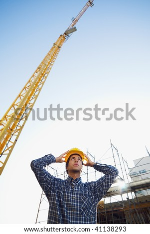 construction worker wearing hard hat. Low angle view, copy space