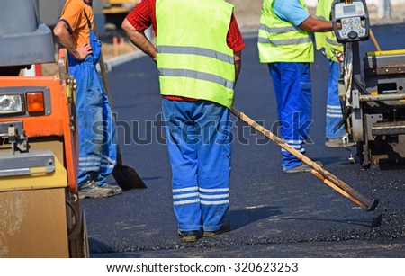 Construction workers at the road construction