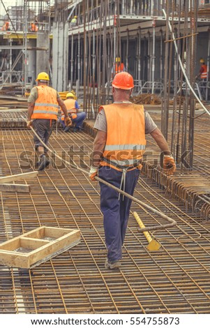 Ironworker Workers Working On Concrete Reinforcements