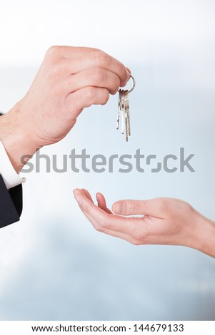 Consultant Giving Keys To Woman In Office