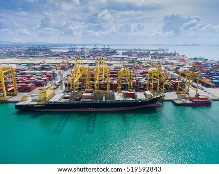 container,container ship in import export and business logistic.By crane , Trade Port , Shipping.Tugboat assisting cargo to harbor.Aerial view.Top view.