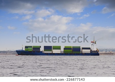 Small Shipping Barge Taking Containers Across Stock Photo ...