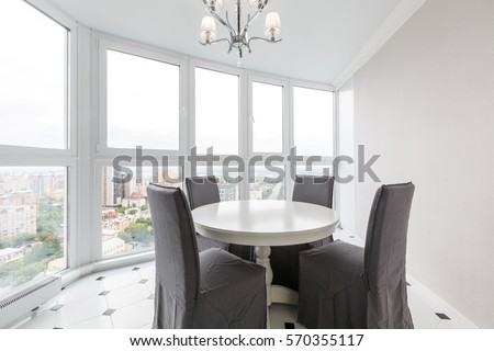 Contemporary Interior Design Of Dining Room In A Luxurious Apartment