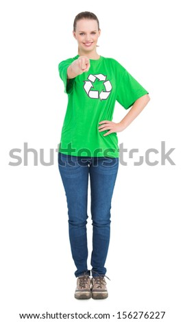 Content pretty environmental activist pointing the camera with her finger on white background