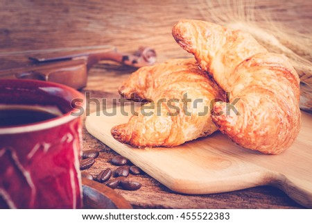 Continental breakfast with coffee and croissant
