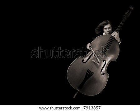 Contrabass musician over black background