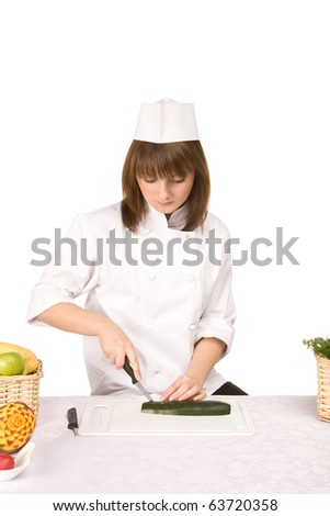 Cook girl cuts the squash - isolated on white