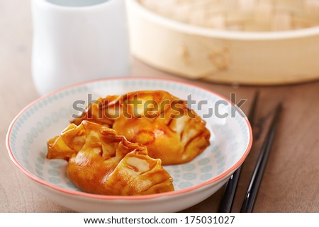 Cooked dim sums chinese dumplings with soy sauce
