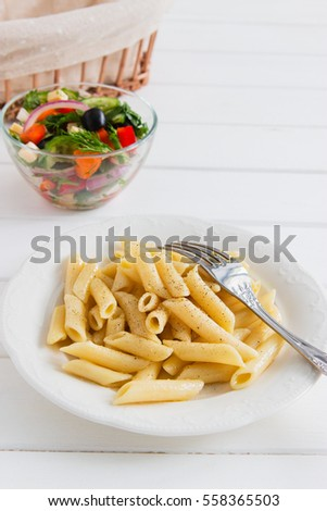 cooked penne with useful vegetables salad.