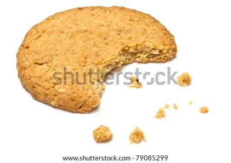 Cookie with crumbs side view isolated on white